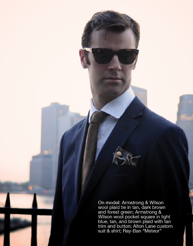 """Armstrong & Wilson wool plaid tie in tan, dark brown and forest green; Armstrong & Wilson wool pocket square in light blue, tan, and brown plaid with tan trim and button; Alton Lane custom suit & shirt; Ray-Ban """"Meteor"""" sunglasses`"""