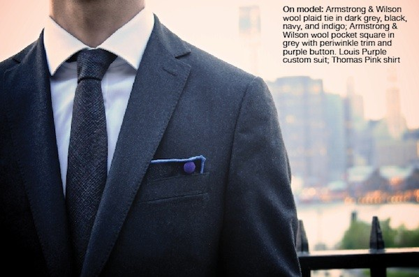 On model: Armstrong & Wilson wool plaid tie in dark grey, black, navy, and indigo; Armstrong & Wilson wool pocket square in grey with periwinkle trim and purple button. Louis Purple custom suit; Thomas Pink shirt