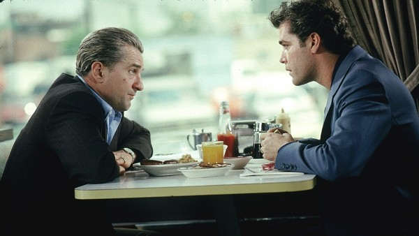 Left to right: Robert De Niro as James Conway sitting in restaurant booth with Ray Liotta as Henry Hill.
