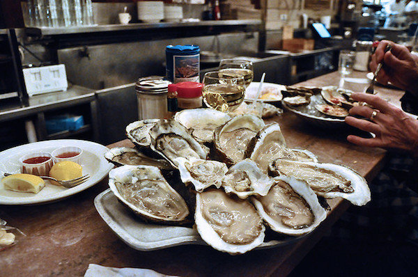 A plate of oysters and a glass of sauvignon blanc at The Oyster Bar in New York Grand Central Station.